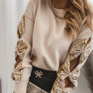 NWOT Beige Sweater with golden sequin bownots